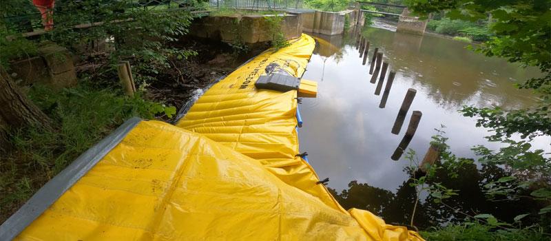 Avvikelse från en arm av floden genom flexibel kofferdam Water-Gate © | Reparation av Bruche-vinnningen i Mutzig